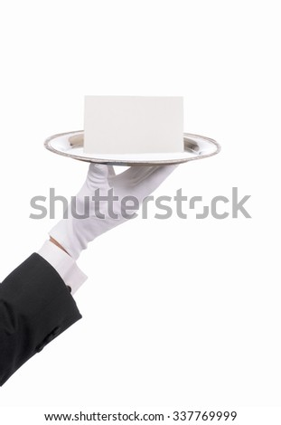 Butlers hand and arm silver serving tray and blank note. Closeup of arm with tuxedo sleeve and formal gloved hand isolated on white. - stock photo