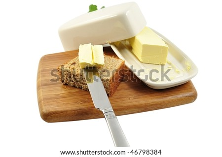 butter and bread on a cutting board