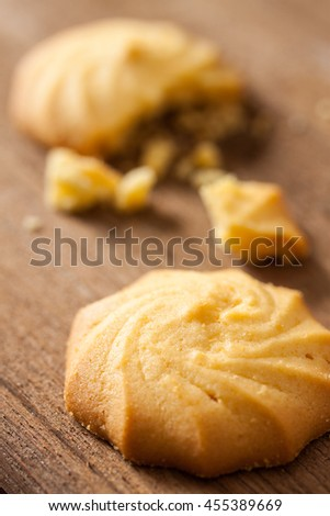 Butter and milk cookies placed on wooden table, selective focus - stock photo
