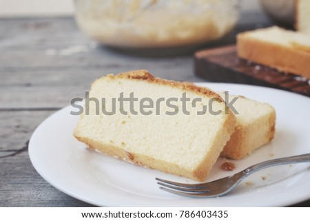 Butter cake on wood background
