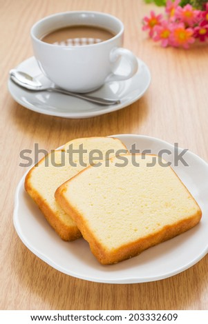 Butter cake sliced on plate and coffee cup - stock photo