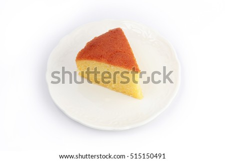 Butter cake sliced on plate isolated on white background