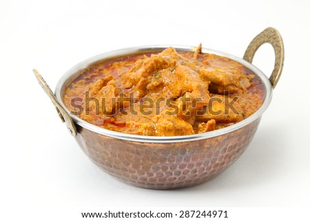 Butter chicken curry, Mutton Curry or Egg Curry isolated on white background in a copper brass bowl. - stock photo