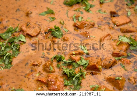 Butter chicken curry ready to be seved  - stock photo