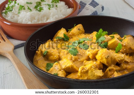 Butter chicken curry with basmati rice and cilantro. - stock photo