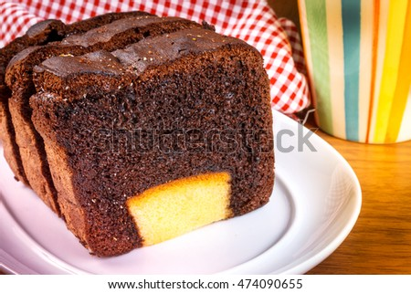 Butter chocolate cake,Slice butter cake on white plate