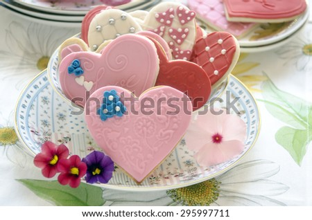 Butter cookies decorated with heart-shaped with fondat - stock photo