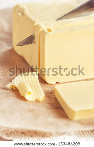 Butter cutting by knife - stock photo
