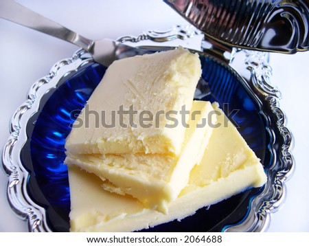 Butter in a butterdish on a white background