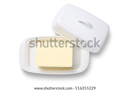 Butter in white ceramic butter dish shot from overhead isolated on white with clipping path