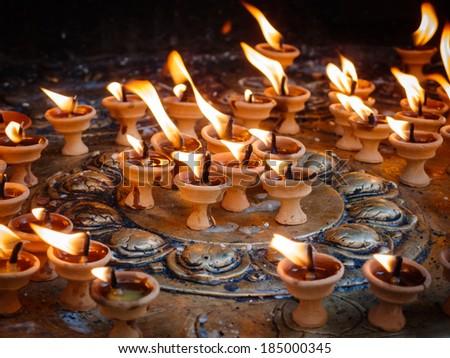 Butter lamps at Swayambhunath Stupa in Kathmandu, Nepal - stock photo