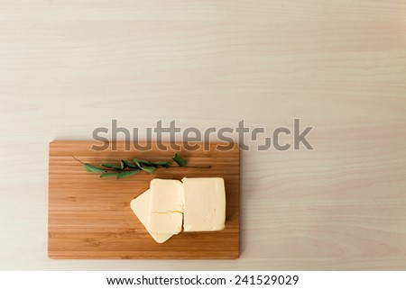 Butter on cutter board - stock photo