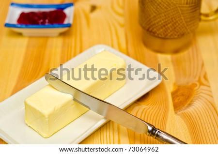 Butter on grey butterdish - stock photo
