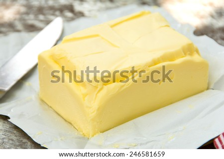 butter on paper - stock photo