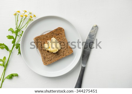 Butter on Toast for breakfast - stock photo