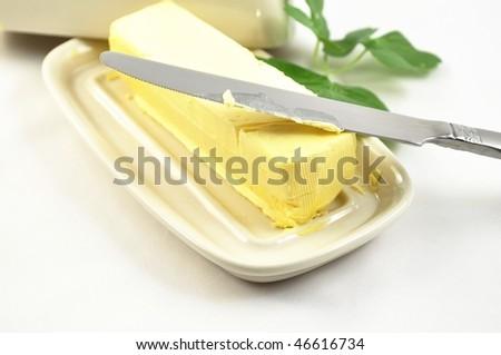 butter on white butterdish - stock photo