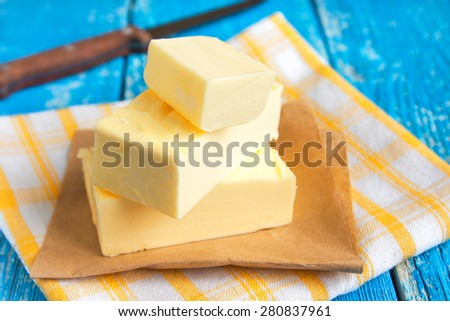 Butter over rustic blue wooden table - stock photo