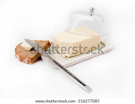 Butter spreading on bread slice - stock photo