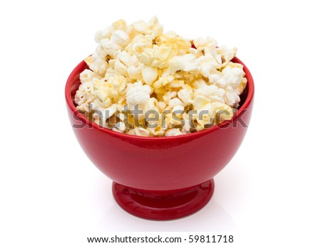 Buttered popcorn snack in a bright red bowl isolated over white,  Tasty Butter Popcorn - stock photo
