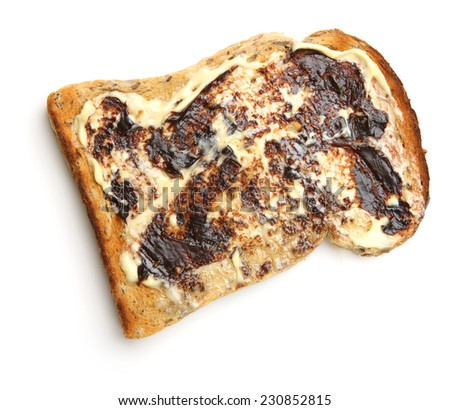 Buttered toast with yeast extract spread. - stock photo