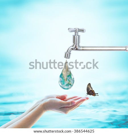 Butterfly drinking water from green globe droplet fall from tap faucet on women hand on blur blue sea ocean day background: Saving aqua h2o conceptual csr idea: Element of this image furnished by NASA - stock photo