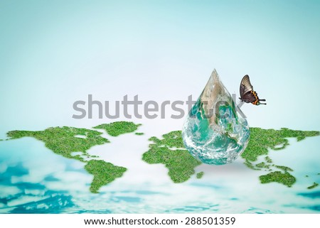 Butterfly drinking water from green globe water drop with world map and blue ocean background: World environment concept to combat desertification and drought: Elements of this image furnished by NASA - stock photo
