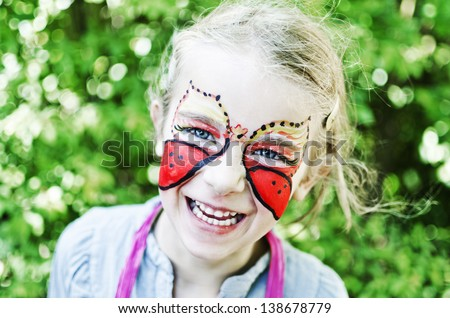 Butterfly face painting - stock photo