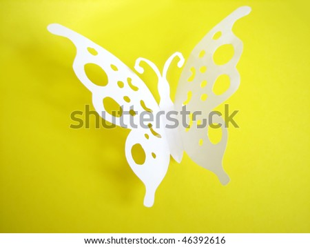 butterfly from paper on bright background - stock photo