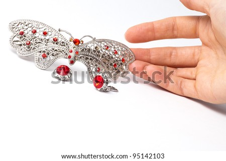 Butterfly hair grip on white background - stock photo