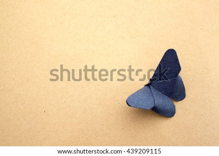 Butterfly paper on brown paper - stock photo