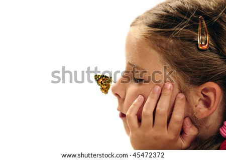 butterfly resting on the nose of a girl, concept for dreams, positive future, imagination and children creative mind