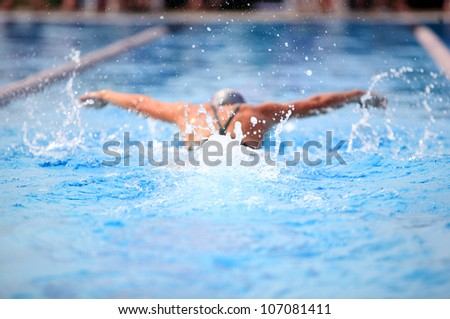 Butterfly Stroke (shallow depth of field, focus on water) - stock photo