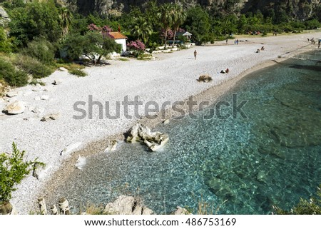 BUTTERFLY VALLEY BEACH, TURKEY - JUNE 01: Tourists visit famous Butterfly Valley beach near Oludeniz in Turkey on JUNE 01, 2016. Butterfly Valley  beach is one of the best beaches in Turkey