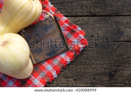 Butternut squash with Board on wooden table, flat lay and copyspace - stock photo