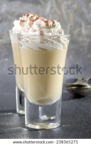 butterscotch made from brown sugar and butter with whipped cream and cocoa powder in a shot glass