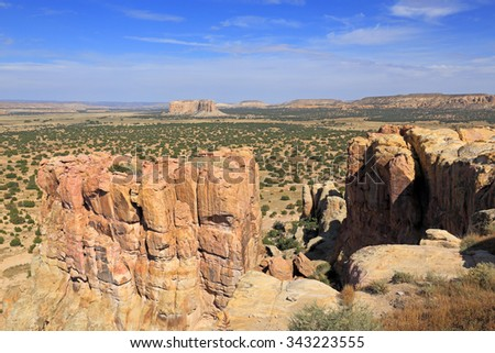 Buttes and spires can be seen for miles from atop the Acoma Pueblo mesa in New Mexico. - stock photo
