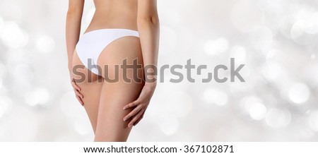 buttocks woman isolated on blurred lights background - stock photo