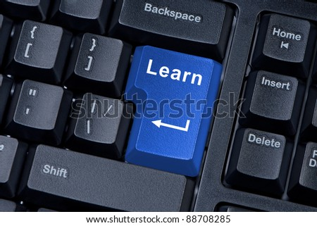 Button learn computer keyboard concept of education. - stock photo