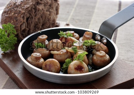 Button mushrooms in a garlic butter - stock photo