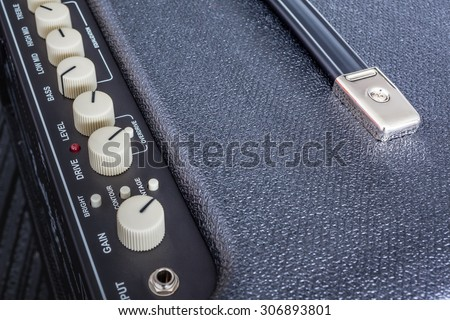 Button of Guitar Power Amplifier, closeup view background - stock photo