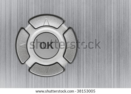 Button ok and metal texture - abstract technology background - stock photo