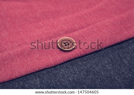 Button on clothes - stock photo