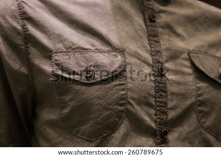 Button on clothes close up -  wear clothes fashion background. - stock photo