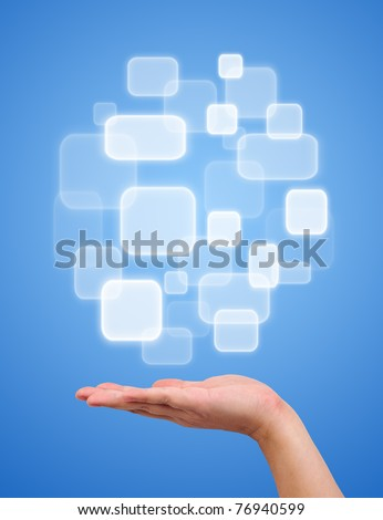 Button over a hand on blue background - stock photo