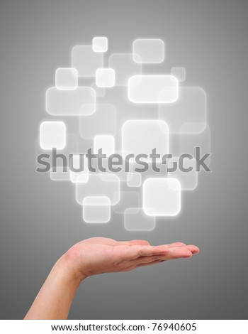 Button over a hand on gray background - stock photo