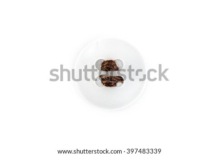 button with brown thread on white background
