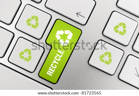 Button with recycle symbol on modern aluminum keyboard. - stock photo