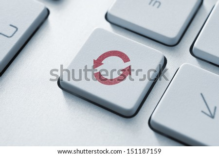 Button with update or syncrhonize icon on a modern computer keyboard.  - stock photo