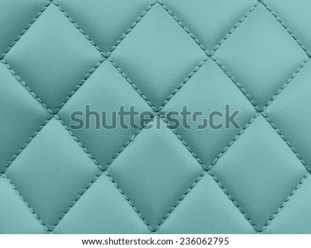 Buttoned on the green blue Texture. Repeat pattern - stock photo