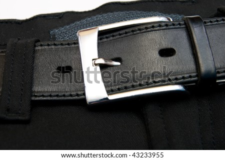 Buttoned strap on black jeans - stock photo